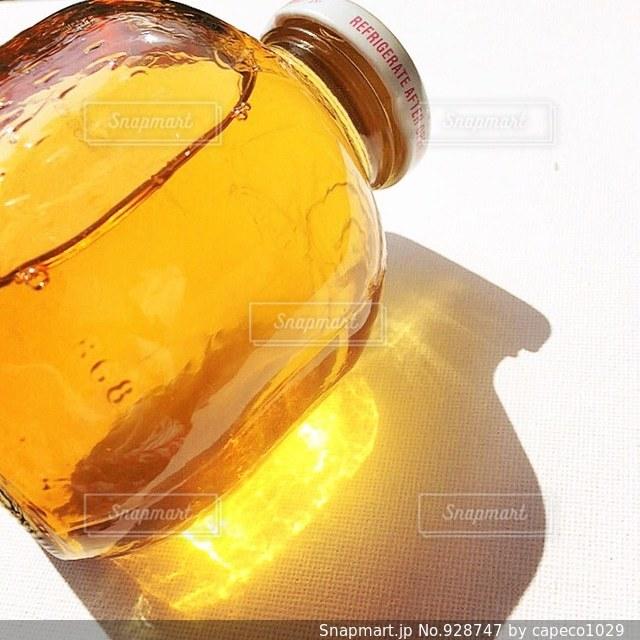 オレンジ ジュースのガラスの写真・画像素材[928747]