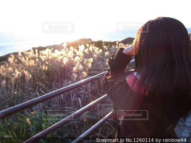 日が昇る様を、新たな気持ちで見つめる。の写真・画像素材[1260114]