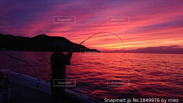 釣り人と夕焼けの写真・画像素材[1849976]