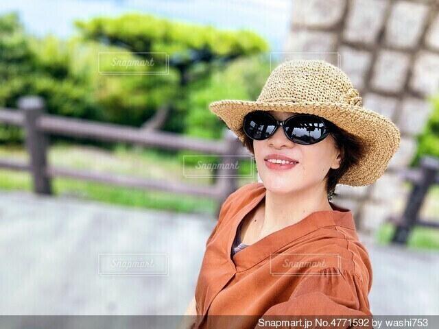 帽子とサングラス。の写真・画像素材[4771592]