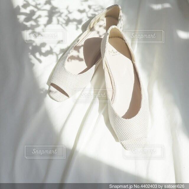 サンダルのおしゃれな置き画の写真・画像素材[4402403]