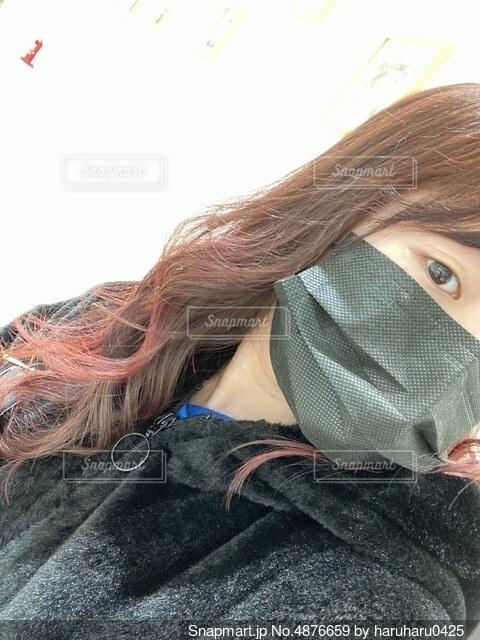 髪の毛染めた暖色カラーピンクカラーの写真・画像素材[4876659]