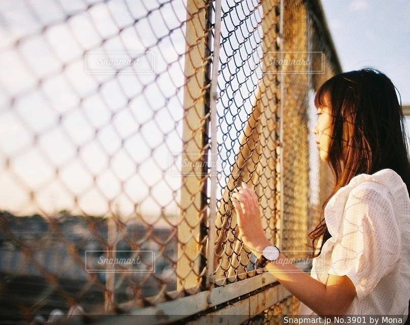 夕日と女性のの写真・画像素材[3901]