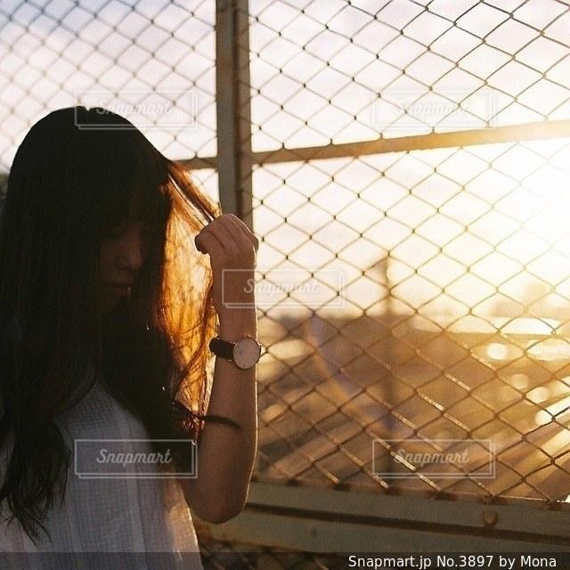 夕日と女性のの写真・画像素材[3897]