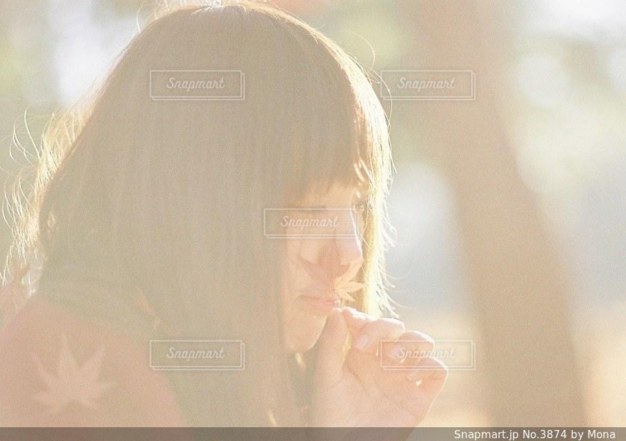 女性の横顔のの写真・画像素材[3874]
