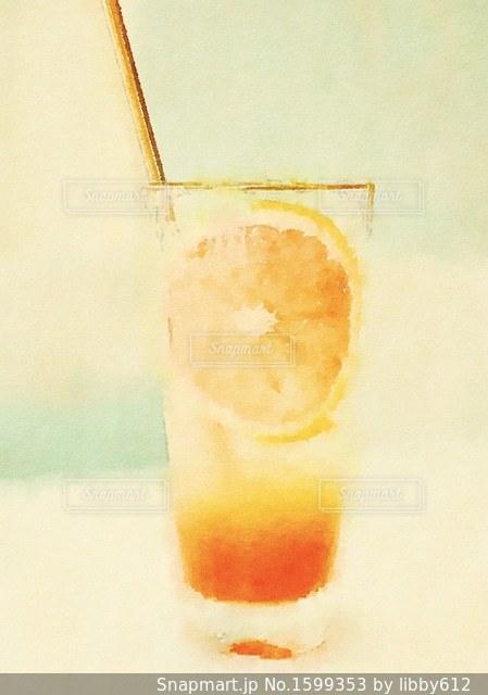 オレンジ ジュースのガラスの写真・画像素材[1599353]