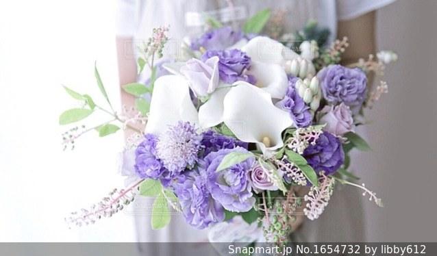 手持ち花束の写真・画像素材[1654732]