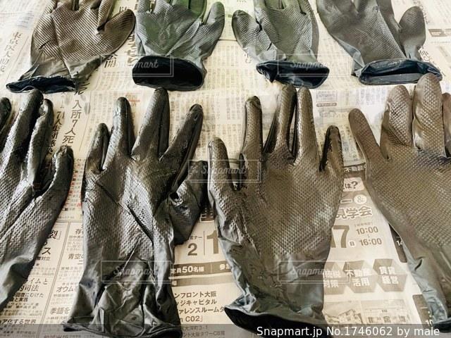 黒ゴム手袋の写真・画像素材[1746062]