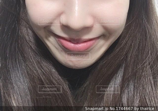 女性の口元のアップの写真・画像素材[1744667]