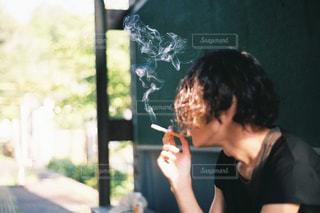 黄昏タバコの写真・画像素材[710969]