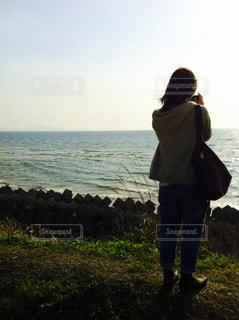 海,後ろ姿,夕方,リラックス,休み,鹿児島,隠し撮り