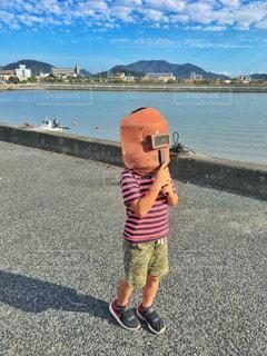 半袖とお面と夏の太陽🌞の写真・画像素材[2160699]