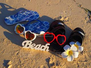 海,花,夕日,サングラス,ビーチ,サンダル,砂浜,沖縄,ハート,ビーチサンダル