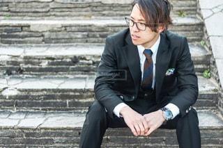 メガネをかけたスーツの男性の写真・画像素材[3642050]