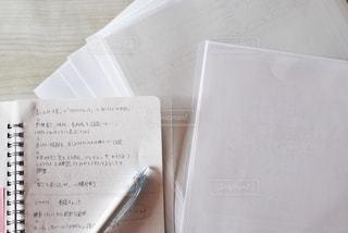 書類とノートの写真・画像素材[2763473]