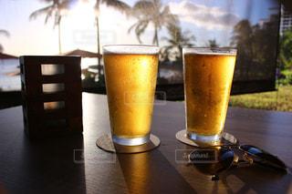自然,海,夕日,ディナー,ビーチ,夕焼け,夕暮れ,グラス,ビール,ハワイ,乾杯,夕陽,ドリンク,サンセット,ハワイ旅行,地ビール,サンセットディナー