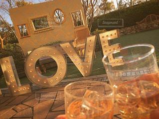 夕日,屋外,テラス,結婚式,夫婦,グラス,乾杯,ドリンク,ウェルカムドリンク,ウェディング,披露宴会場