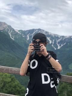 空,カメラ,自撮り,屋外,山,景色,人物,人,一眼レフ