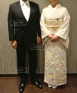 礼服と色留袖の夫婦の写真・画像素材[3020160]
