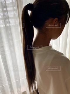 ポニーテールの女の子の写真・画像素材[2302844]
