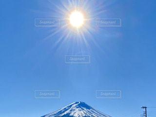 自然,空,富士山,雪,太陽,青空,山,日差し,光,眩しい,斜面,日中