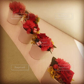 旅先のカフェの一角の花鉢の写真・画像素材[2297557]