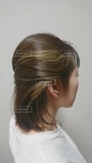 かきあげヘアスタイルの写真・画像素材[2299289]