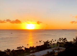 風景,海,空,夕日,屋外,太陽,雲,晴れ,夕焼け,夕暮れ,水面,光,旅行,ハワイ