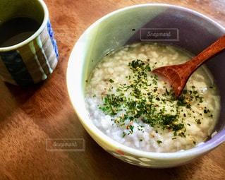 今朝の朝ごはん、おかゆの写真・画像素材[2489238]