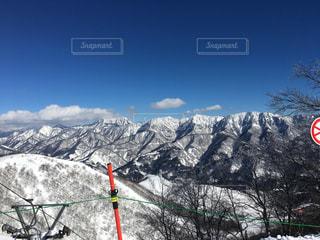 アウトドア,空,スポーツ,雪,屋外,山,樹木,人物,スキー,山頂,スノボ,ゲレンデ,眺望,レジャー,スノーボード,斜面