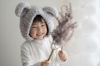 帽子をかぶった少年のクローズアップの写真・画像素材[2904058]