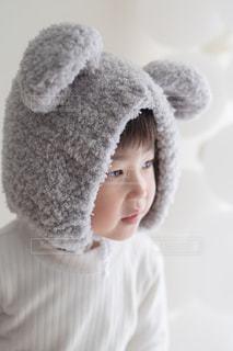 帽子をかぶった少年のクローズアップの写真・画像素材[2904115]