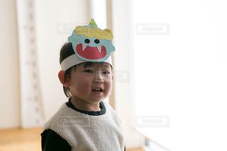 帽子をかぶった少年の写真・画像素材[2924134]