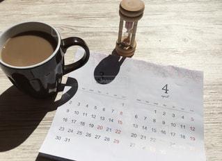 テーブルの上にコーヒーを一杯入れるの写真・画像素材[3033597]