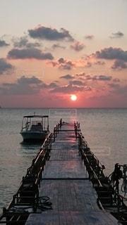 海,空,夕日,太陽,夕焼け,光,欄干
