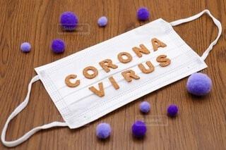 新型コロナウイルスとマスクの写真・画像素材[3977299]