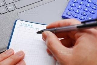 キーボード上の手帳、計画表の写真・画像素材[4003889]