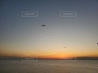 自然,風景,海,空,太陽,夕暮れ,飛行機,海岸,光