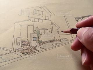 鉛筆を持つ手の写真・画像素材[3000871]