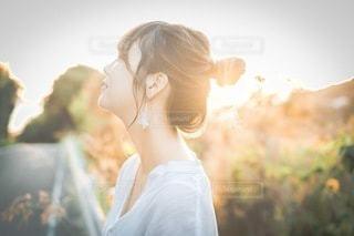 夕焼けと女の子の写真・画像素材[3401453]