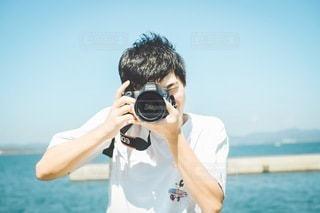 カメラと海の写真・画像素材[3549085]