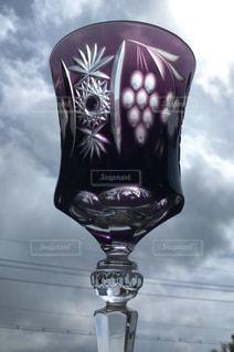 ワイングラスと空の写真・画像素材[3123635]