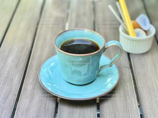 水色のコーヒーカップの写真・画像素材[4838323]