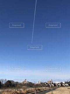 快晴の飛行機雲の写真・画像素材[3099059]