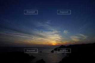 伊豆石廊崎海に沈む美しい夕陽の写真・画像素材[3440141]