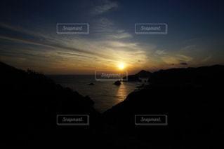 伊豆石廊崎海に沈む美しい夕陽の写真・画像素材[3440150]