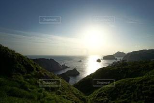 伊豆石廊崎海に沈む美しい夕陽の写真・画像素材[3440163]