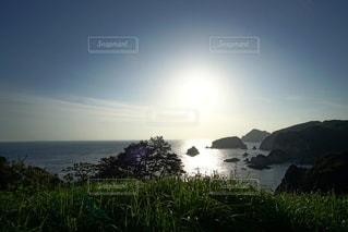 伊豆石廊崎海に沈む美しい夕陽の写真・画像素材[3440164]