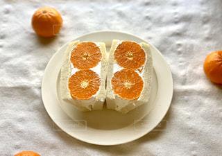 手作りオレンジサンドイッチの写真・画像素材[3188797]