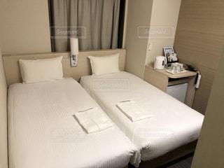 ホテル,ビジネスホテル,寝室,ベッド,インテリア デザイン